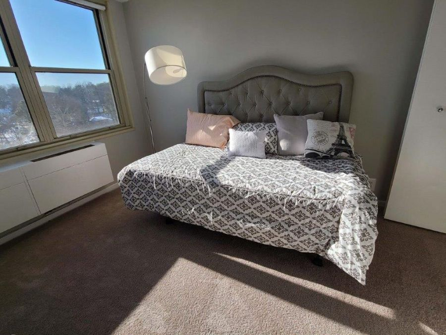 spacious bedroom with scenic views
