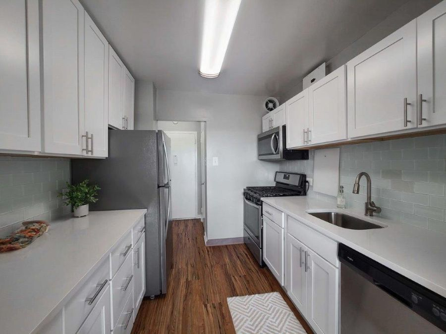 white kitchen with updated appliances